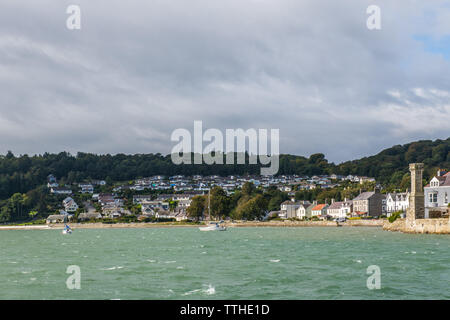 The seafront at Beaumaris on the coast of Anglesey North Wales on a mixed weather day - Stock Image