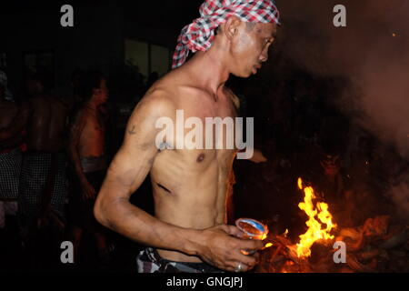 A Man with the Fire on his Hand - Stock Image