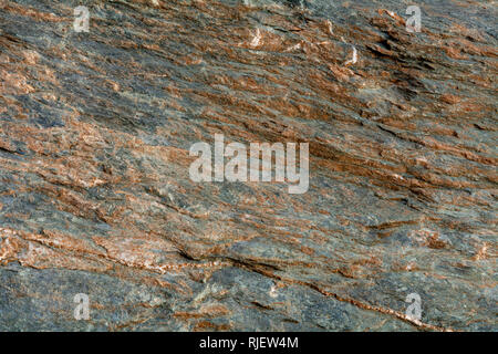 Gneiss, a common type of metamorphic rock, is formed by high temperature and high-pressure metamorphic processes acting on the formation of igneous or - Stock Image