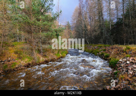 Allt Ruadh, a tributary of the River Feshie, in Glen Feshie, Inverness-shire, Scotland. March. - Stock Image