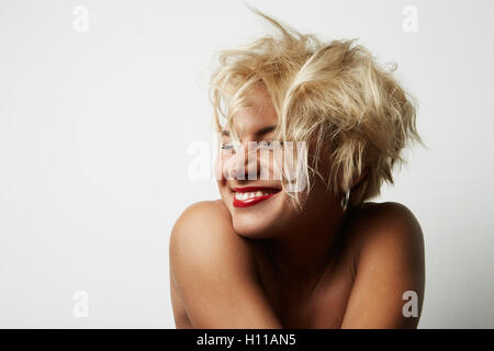 Portrait Young Blonde Head Female Perfect Skin Showing something Interesting Copy Space Wall Your Business Information - Stock Image