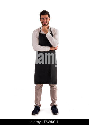 Full length shot of young chef or waiter posing - Stock Image