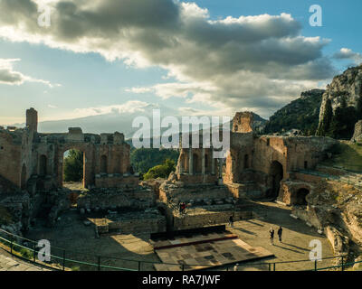 View from the Theatre in Taormina towards Mount Etna with the seaside town of Giardini Naxos visible, Province of Messina, Sicily, Italy - Stock Image