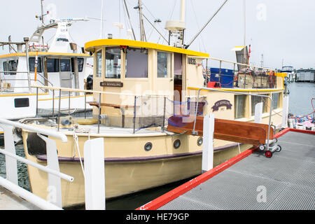 A vintage timber fishing boat from 1952 in the harbour at Lakes Entrance in Victoria, Australia. - Stock Image