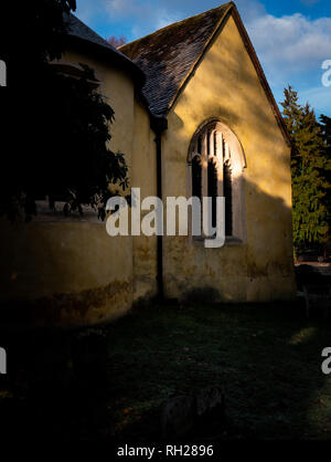 Portrait English village church in early morning sunlight - Stock Image