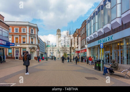 A view down George Street, a pedestrianised shopping street in Luton, Bedfordshire, UK. At the far end is the town hall. - Stock Image