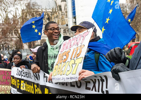 London, UK. 15th January 2019. Movement for Justice protesters call Brexit racist and support free movement.  Groups against leaving the EU, including SODEM, Movement for Justice and In Limbo and Brexiteers Leave Means Leave and others protest opposite Parliament as Theresa May's Brexit deal was being debated.  While the two groups mainly kept apart, a small group, some in yellow jackets came to shout insults at pro-EU campaigners, while police tried to keep the two groups separate. Credit: Peter Marshall/Alamy Live News - Stock Image