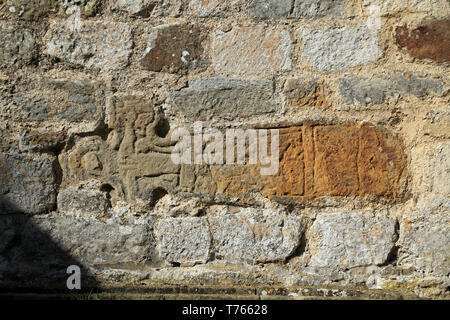 Anglo Saxon or Viking crosses incorporated into wall of St Gregory's Minster, Kirbymoorside, Kirkdale, North Yorkshire, England, United Kingdom - Stock Image