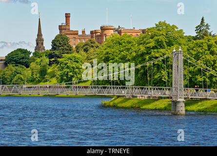 INVERNESS CITY SCOTLAND THE RED STONE CASTLE AND INFIRMARY PEDESTRIAN BRIDGE OVER THE RIVER NESS - Stock Image