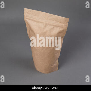 Mockup craft paper pouch bag over gray - Stock Image