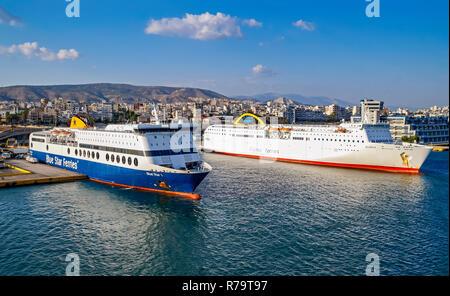 Car and passenger ferries Blue Star Ferries Blue Star 1 & ANEK Algerie Ferries Elyros moored in port of Piraeus Athens Greece Europe - Stock Image