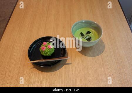 Wagashi sweet shaped like azalea flowers and cold Matcha green tea, Nihonbashi, Chuo-ku, Tokyo, Japan - Stock Image