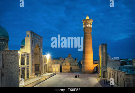 Poi Kalan at dusk - an islamic religious complex located around the Kalan minaret in Bukhara, Uzbekistan - Stock Image