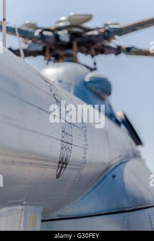 Croatian insignia on Mi-17 Sh helicopter fuselage metal panels surface rivets riveted shiny - Stock Image