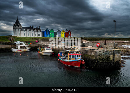 Scenic Harbor With Fishing Boats And Colorful Apartment Houses At John o'Groats In Scotland - Stock Image