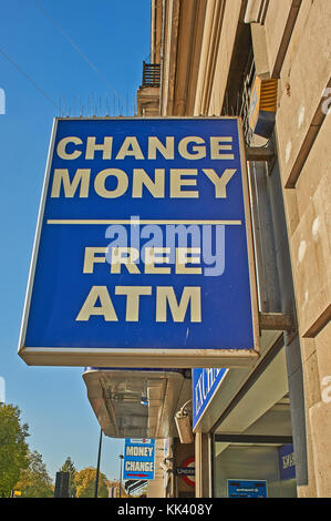 Sign on a building in central London advertising free ATM  and money change facility - Stock Image
