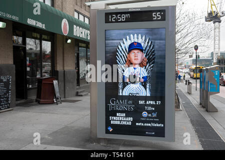 An advertisement for the Game of Thrones & Noah Syndergard bobblehead night. On a sheltered bus top on West 34th St. in Manhattan, New York City. - Stock Image