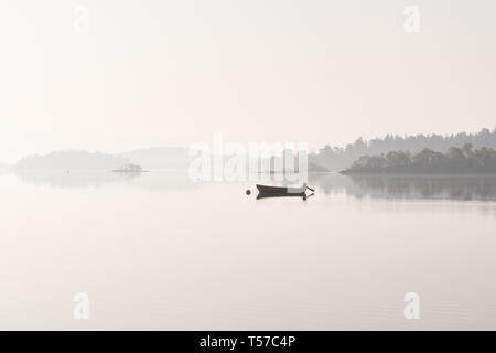 Luss, Loch Lomond, Scotland, UK. 22nd Apr, 2019. uk weather - a glorious still and hazy morning at Luss, Loch Lomond ahead of what is forecast to be a beautiful sunny day Credit: Kay Roxby/Alamy Live News - Stock Image