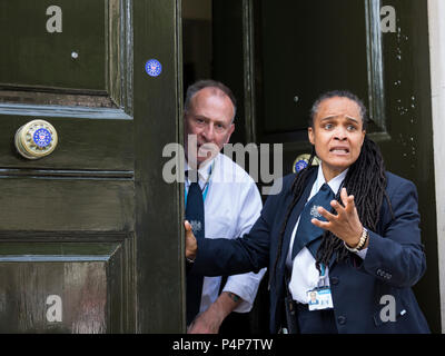 London, UK. 23 June 2018. Government security guards at the Cabinet Office are angry that protesters have defaced the doors with stickers.  Remain supporters and protesters at an Anti-Brexit march and rally for a People's Vote. Photo: Bettina Strenske/Alamy Live News - Stock Image