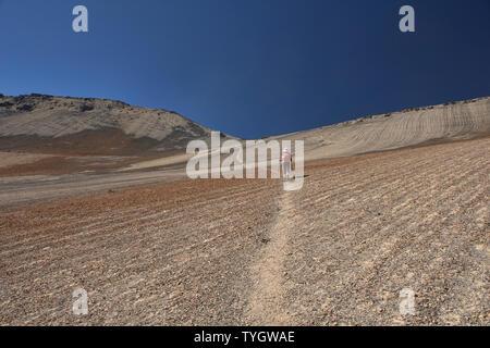 Crossing a high pass to Laguna Juri Khota on the Cordillera Real Traverse, Bolivia - Stock Image