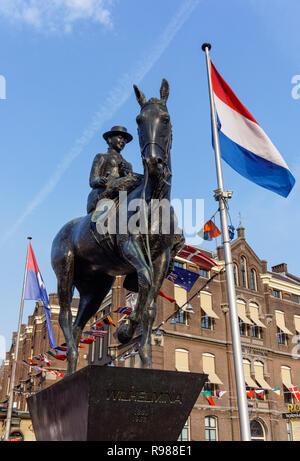 Equestrian statue of Queen Wilhelmina on Rokin street in Amsterdam, Netherlands - Stock Image