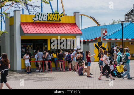 people line up in front of a subway sandwich restaurant in the summer outdoor - Stock Image