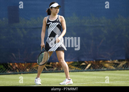 Miharu Imanishi, professional tennis player from Japan, during a match at a grass court tournament in the United Kingdom in 2018. - Stock Image