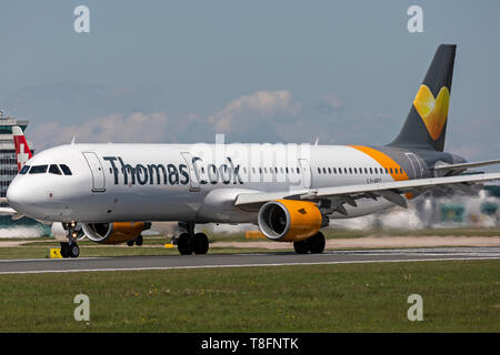Thomas Cook Airbus A321-200, registration LY-VEC, preparing for take off from Manchester Airport, England. - Stock Image