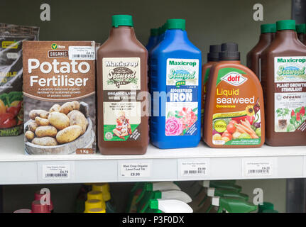 A range of fertiliser products on sale at The Walled garden plant nursery, Benhall, Suffolk, England, UK - Stock Image