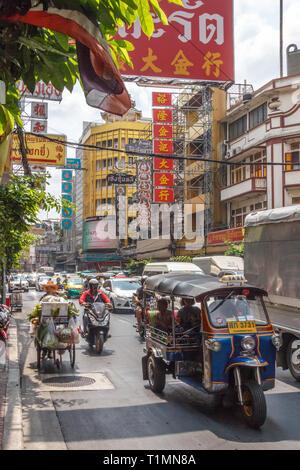 Bangkok, Thailand - 7th March 2017: Tuk tuk amongst heavy traffic on Yaowarat road. The road is the main artery through Chinatown. - Stock Image