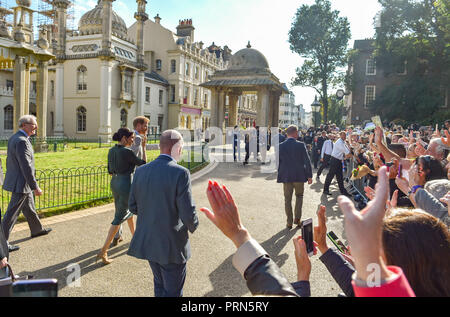 Brighton UK 3rd October 2018 - The Duke and Duchess of Sussex walk by the crowds holding hands after visiting the Royal Pavilion in Brighton today as part of their first visit to the county where they have been to Chichester and Bognor as well as Brighton Credit: Simon Dack/Alamy Live News - Stock Image