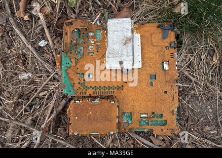 The rusty remnants of a computer motherboard found at a building site. Could be one of the future archaeological finds from our time, if it will last - Stock Image