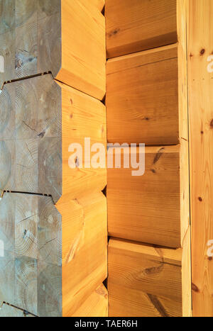 Close-up of manufactured Scots pinewood beams used to construct a wall inside a piece sur piece Scots pine log home, Quebec, Canada. This image is property released. CUPR0334 - Stock Image