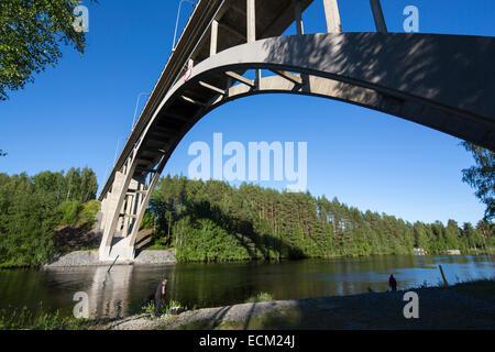 30 meters high concrete arch road bridge over river Leppävirta  , Finland - Stock Image