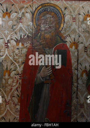 Painted Saint on the Rood Screen, St Bartholomew Apostle holding a knife, much defaced; St Michael's Church, - Stock Image