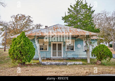 Front exterior entrance to old country home or house in rural Georgia, USA, with two front doors side by side. - Stock Image