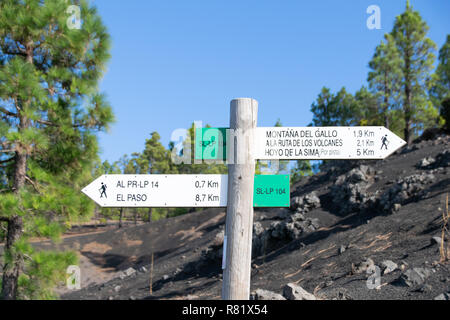 Walking signs for hiking through the volcanic landscape at Mirador Llando des Jable, La Palma, Canary Islands, Spain - Stock Image