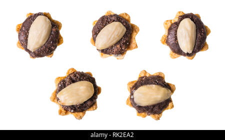 Set of sweet cupcakes with chocolate and almond. Isolated on white background. Group of yummy pastries decorated by brown cocoa filling. Xmas cookies. - Stock Image
