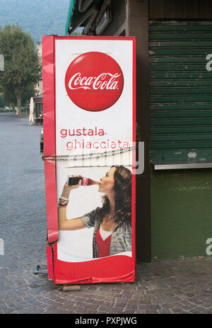 a Coca Cola vending machine on the street in Italy - Stock Image