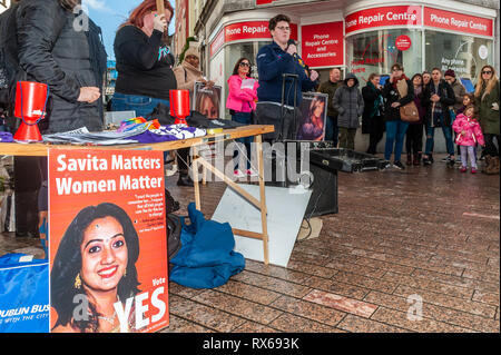 Cork, Ireland. 8th March, 2019. University College Cork Student Union Equality Officer Maebh Richardson spoke whilst standing near a poster of Savita Halappanavar at a '#Walkout 4 Equality' protest on International Women's Day on Patrick Street, Cork. Savita Halappanavar died after doctors refused to perform an abortion when she was miscarrying her baby during child birth in October 2012. The women are protesting sexual violence, the 14% pay gap and the cervical check scandal, as well as other issues. Credit: Andy Gibson/Alamy Live News. - Stock Image
