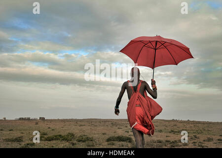 Maasai Warrior Tribesman in Traditional Dress with Blue Sky. Kenya, Africa. - Stock Image