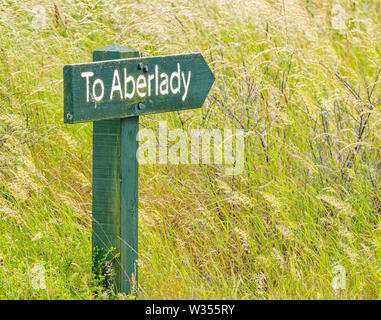 Wooden signpost pointing the way to Aberlady, Aberlady Nature Reserve, East Lothian, Scotland, UK - Stock Image