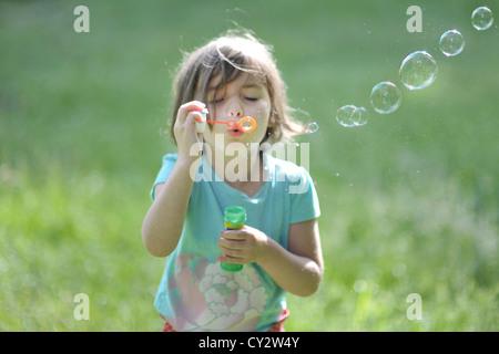 bubbles girl kid serendipity - Stock Image
