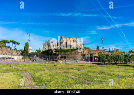 Rome, Italy - 24 June 2018: The ancient ruins at the Roman Forum of Temple of Venus and Roma at Rome viewed from the colosseum. Famous world landmark - Stock Image
