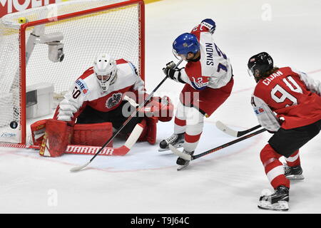 Bratislava, Slovakia. 19th May, 2019. L-R Goaltender Lukas Herzog (AUT), Dominik Simon (CZE) and Alexander Cijan (AUT) in action during the match between Austria and Czech Republic within the 2019 IIHF World Championship in Bratislava, Slovakia, on May 19, 2019. Credit: Vit Simanek/CTK Photo/Alamy Live News - Stock Image