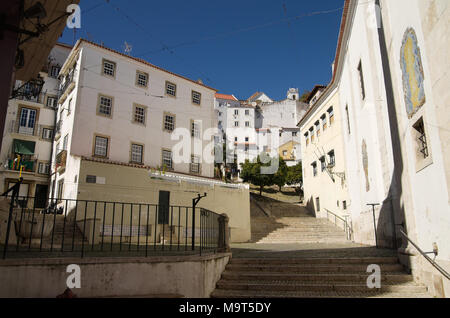 San Miguel staircases amongst old buildings in Alfama disctrict, the most famous and ancient typical neighborhood of Lisbon. Portugal. - Stock Image