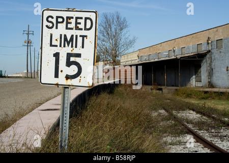 15 asphalt box car concrete fifteen hour levee limit Louisiana miles Mississippi New Orleans overgrown per rail - Stock Image
