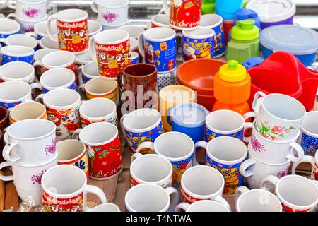 Assorted Artisan Tea and Coffee Cups with Christmas Motif  Picture taken on a market day in Chichicastenango, Guatemala - Stock Image