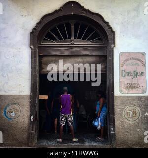 Locals hanging in shop in Havana Cuba - Stock Image