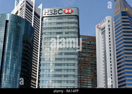 The skyscrapers of the Singapore Business Financial District around Raffles Place, with Bank of China, Maybank and HSBC prominent. - Stock Image